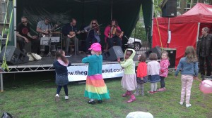 Kids dancing in front of the Goose stage, Goose Green